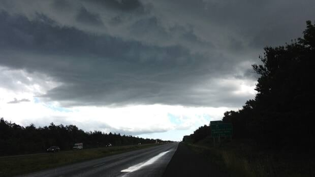 Storm clouds gather over Highway 118.