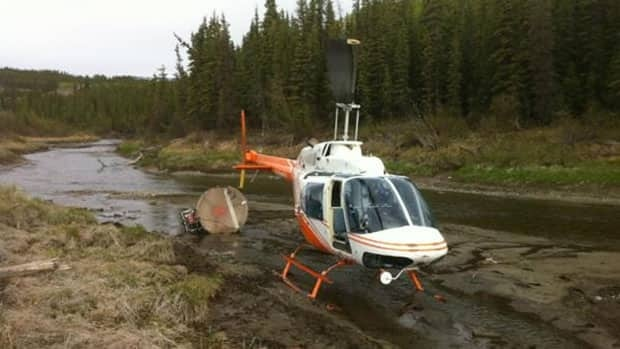 The pilot walked away from the accident, which took out power lines in Whitehorse and ended up in a creek.
