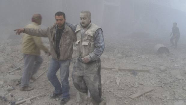 Activists say forces loyal to Syrian President Bashar al-Assad fired missiles Dec. 1, damaging buildings in a Damascus suburb.