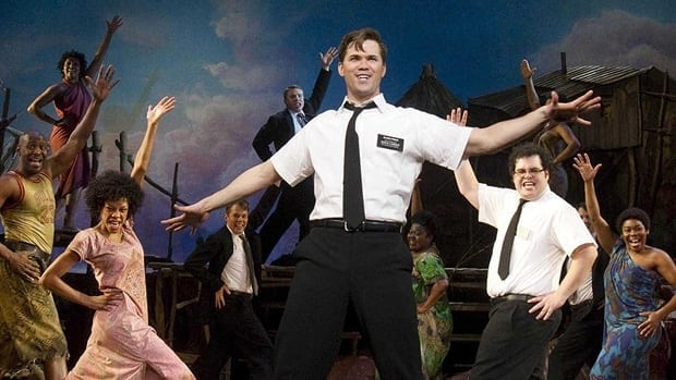 Andrew Rannells, centre, performs with the cast of The Book of Mormon in New York. The hit Broadway production makes its Canadian debut in Toronto in spring 2013.