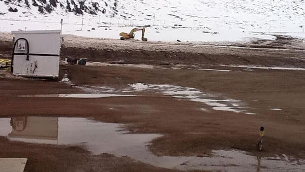 The runway in the community of Qikiqtarjuaq, Nunavut, was flooded earlier this month. New flooding means repair costs are jumping to double what they originally were going to be.