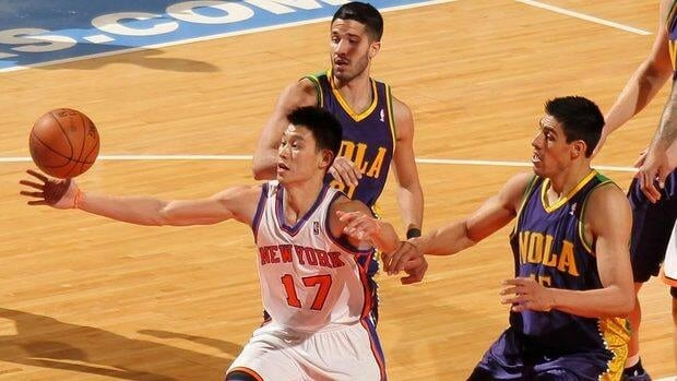Jeremy Lin (17) of the New York Knicks reaches for a rebound against Gustavo Ayon (15) of the New Orleans Hornets on Friday. Lin scored 26 points, but his turnovers nearly doubled his five assists.