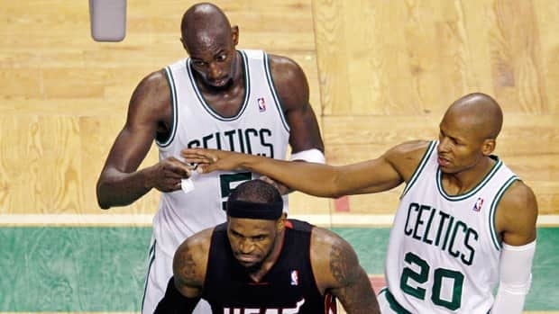 Boston Celtics forward Kevin Garnett, top left, is separated from Miami Heat forward LeBron James by Celtics guard Ray Allen after they collided during the third quarter of Game 4 in Boston on Sunday.