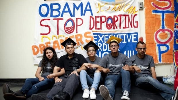 From left, Myisha Areloano, Adrian James, Jahel Campos, David Vuenrostro, and Antonio Cabrera camp outside of the Obama campaign headquarters in Culver City, Calif., in protest of immigration policies. The U.S. president eased enforcement of immigration laws Friday.