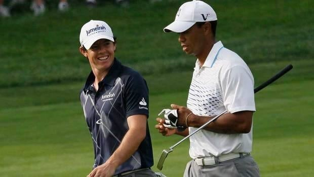 Rory McIlroy, left, has been nicknamed 'The Intimidator' by Tiger Woods, right.