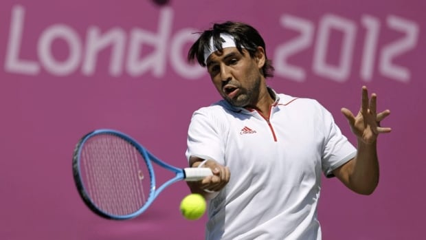 Marcos Baghdatis of Cyprus returns a shot at Wimbledon in London at the 2012 Summer Olympics. A B.C. man was reportedly arrested Saturday for allegedly scalping tickets to a tennis match at the Games.