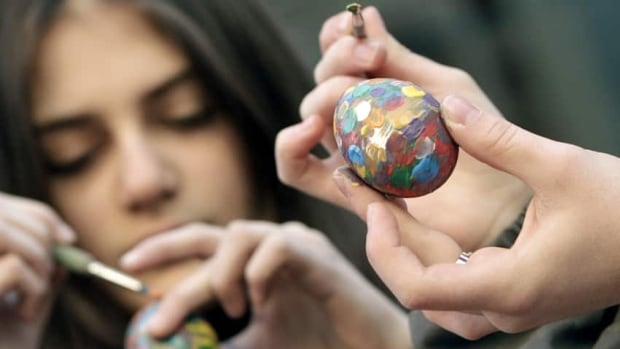 Easter eggs come in all shapes sizes in colours, especially in Eastern Europe. Here, children paint eggs for Easter in Tbilisi, Georgia. (David Mdzinarishvili/Reuters)