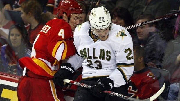 Calgary defenceman Jay Bouwmeester and Dallas forward Tom Wandell battle in a game earlier this season.