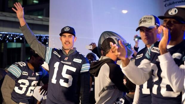 Toronto Argonauts quarterback Ricky Ray (15) waves to fans at a Grey Cup rally in Toronto on Tuesday.