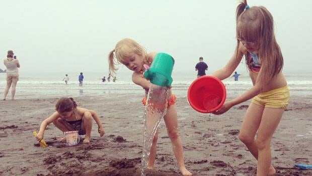 The Smith girls playing on Mispec beach. There are severe weather warnings across the Maritimes for July 20, 2013.