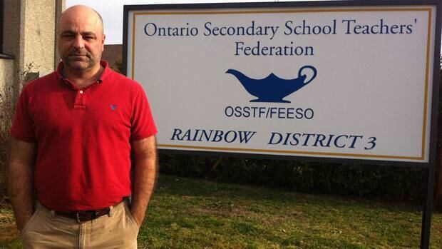 James Clyke, local union president for the Ontario Secondary School Teachers' Federation, stands outside the union office in Lively, Ont.