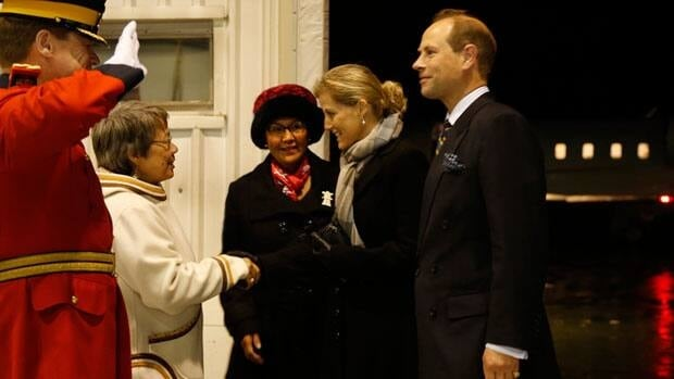 Nunavut Premier Eva Aariak greets Sophie, Countess of Wessex, and her husband Prince Edward, Earl of Wessex, at the Iqaluit airport Wednesday night as Nunavut Commissioner Edna Elias looks on.