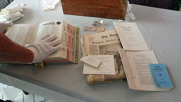 The Hamilton-Wentworth District School Board opened a time capsule Tuesday that was placed under the cornerstone of its Education Centre in 1966. The event coincided with a protest against high school closures and the demolition of the building. (Samantha Craggs/CBC)