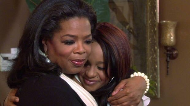 Host Oprah Winfrey, left, embraces Bobbi Kristina, daughter of the late singer Whitney Houston during an interview in Atlanta, Ga., in this image from video released by Harpo, Inc. The exclusive interview aired on the OWN network on Sunday.