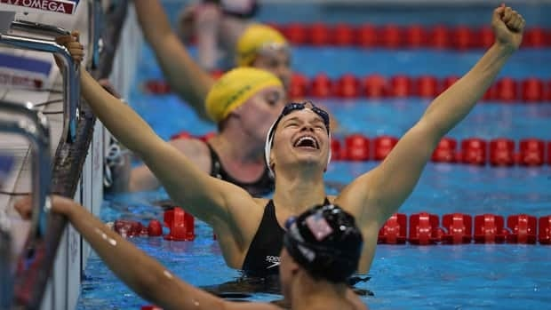 Canadian swimmer Valerie Grand'Maison celebrates her victory in the women's 200m IM in the S13 visually impaired class.