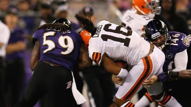 Wide receiver Josh Cribbs of the Cleveland Browns was down for several minutes after taking this from Baltimore linebacker Dannell Ellerbe in the first half.