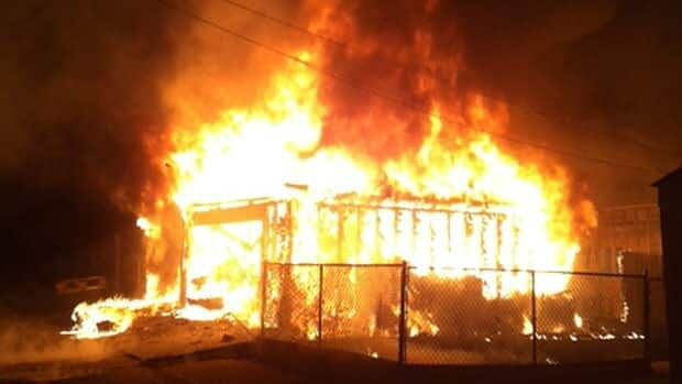 Flames consume a garage on Garlies Street on Thursday morning.