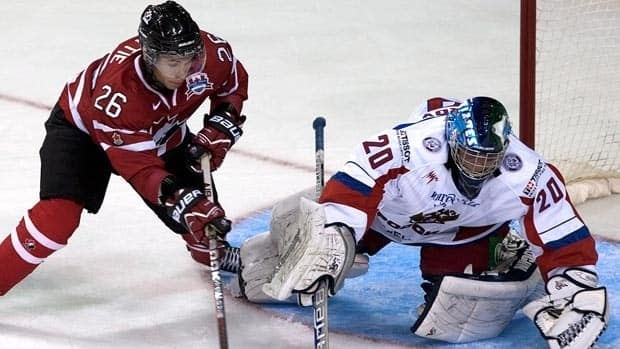 Russia goaltender Andrei Makarov stops Canada's Ty Rattie in first period action in Halifax.