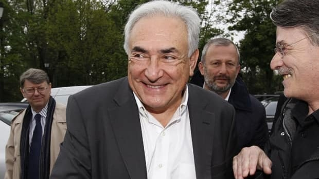 Former IMF head Dominique Strauss-Kahn arrives at a polling station in Sarcelles, France, on May 6. French investigators continue to look into his alleged links to a prostitution ring in France.