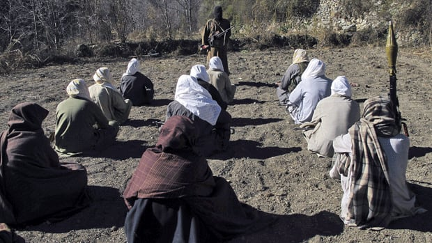 Masked Pakistani Taliban militants take part in a training session in an area of Pakistan's tribal South Waziristan region. Militants claimed Thursday to have killed 15 captured security officers.