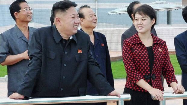 North Korea's new leader, Kim Jong-un, has been seen with a young woman who analysts had speculated might be his wife.  North Korea's state TV has confirmed that Ri Sol Ju is Kim's wife.
