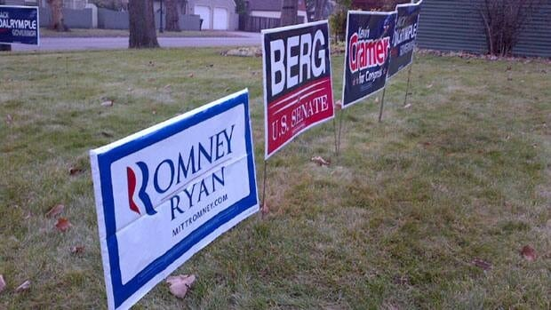 Some U.S. election signs in North Dakota last week. Americans head to the polls on Tuesday.