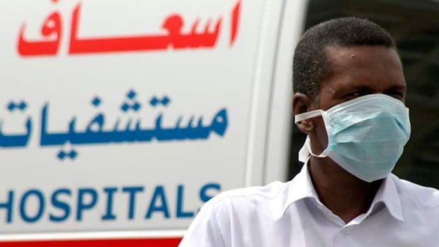A man, wearing a surgical mask as a precautionary measure against the MERS virus, walks near a hospital in Khobar city in Dammam, Saudi Arabia, in May 2013. There have been 79 deaths in Saudi Arabia attributed to MERS since the new coronavirus was identified by scientists in September 2012.