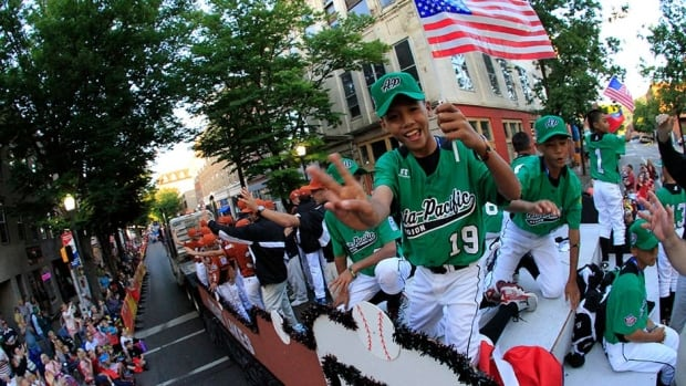 Members of the Little League team from Taiwan ride in the Little League Grand Slam Parade  on Wednesday as it makes its way through downtown Williamsport, Pa. The Little League World Series tournament begins Thursday, but Taiwan's first match is against Canada on Friday.