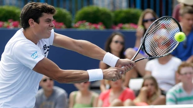 A loss to American John Isner at the Cincinnati Open has knocked Canada's Milos Raonic, shown here, out of the top 10 in the ATP rankings.