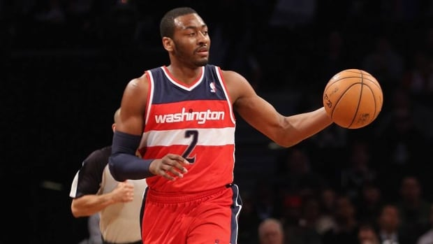 Wizards' franchise player John Wall has agreed to a contract extension to remain in Washington. The deal is reportedly worth $80M over five years.