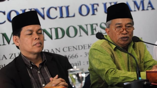 The Indonesia Ulema Council's Muhyidin Junaedi (right) and Amirsyah Tambunan brief journalists during a press conference in Jakarta about their statement concerning the upcoming Miss World beauty pageant.