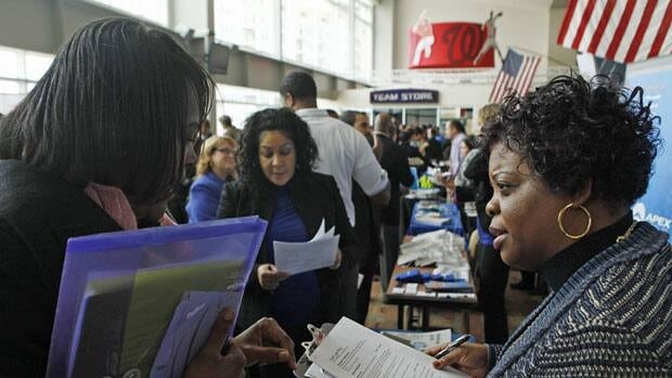 Lolita Hill of Hewlett-Packard interviews an applicant at a job fair held in Washington, D.C., Wednesday.