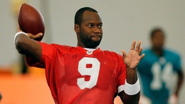 Miami Dolphins quarterback David Garrard practices during NFL football training camp.