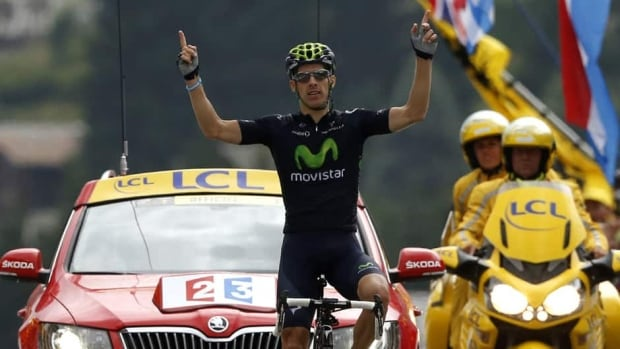 Rui Alberto Costa celebrates as he wins the 19th stage of the Tour de France on July 19, 2013.