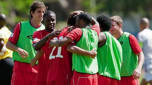 Players on Canada's national football team celebrate their victory over Cuba after their World Cup qualifying match on June 8.