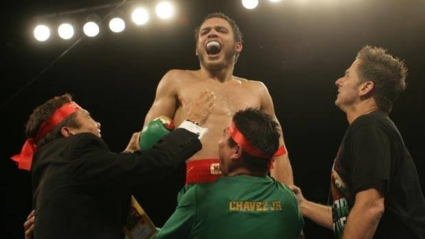 Julio Cesar Chavez Jr. is joined by his supporters after the stoppage win Saturday, including his legendary father on the left.
