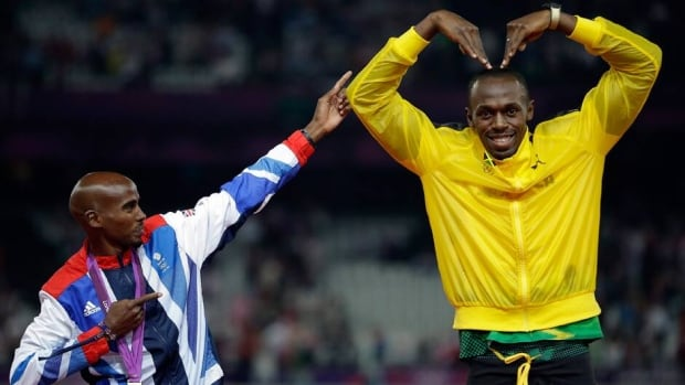 Jamaican sprinter Usain Bolt and British long-distance runner Mo Farah, shown here imitating each other at the London Games Aug. 11, 2012, may soon face each other in a race with a middle distance.
