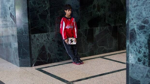 In this Aug. 15 file photo, a young hockey fan waits in the lobby of the building housing the NHLPA offices in Toronto during labour negotiations with the NHL.