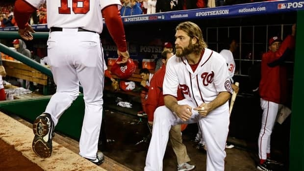 Washington Nationals outfielder Jayson Werth looks on in dejections after watching his team being eliminated by the World Series champion St. Louis Cardinals on Friday.