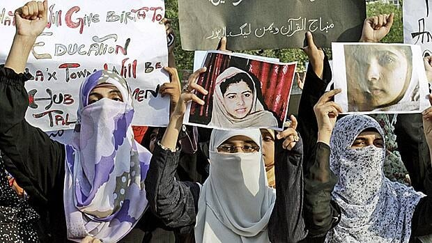 Pakistani women in Lahore hold a vigil for 14-year-old schoolgirl Malala Yousufzai, shot by the Taliban.
