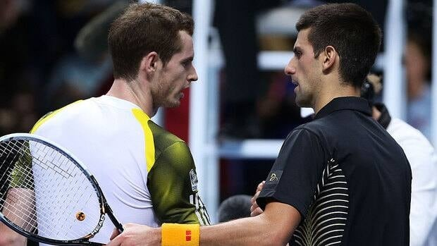 Andy Murray, left, shakes hands with top-ranked Novak Djokovic following their match at the ATP finals Wednesday. Djokovic now leads the third-ranked Murray 10-7 in head-to-head meetings.