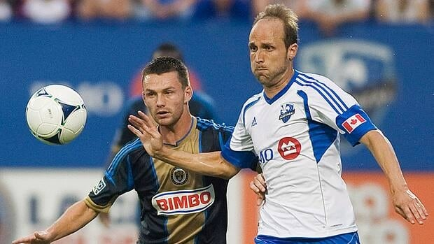 Impact's Justin Mapp, right, and Philadelphia's Jack McInerney battle for the ball during first-half action in Montreal.