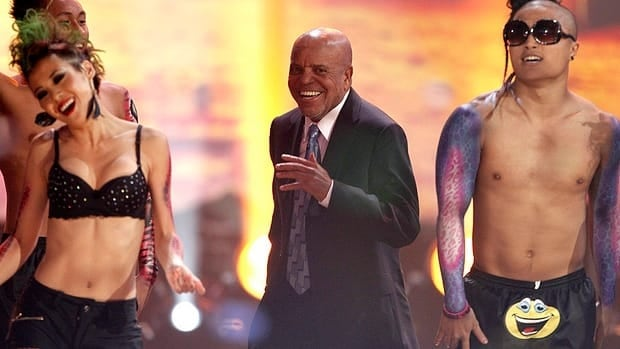 Motown Records founder Berry Gordy Jr., centre, dances onstage at the 2011 American Music Awards during a performance by LMFAO, the electropop duo comprising his youngest son and one of his grandsons.