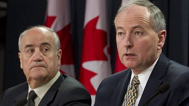 Justice Minister Rob Nicholson, right, and Julian Fantino, associate defence minister and a former police chief, touted the government's omnibus crime bill Wednesday.