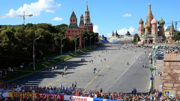 Runners make their way past The Kremlin and St. Basils in Red Square during the men's marathon at the IAAF World Athletics Championships in Moscow.