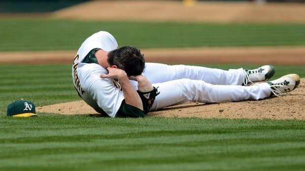 Oakland Athletics pitcher Brandon McCarthy holds his head after being struck by a ball hit by Los Angeles Angels' Erick Aybar in the fourth inning on Wednesday.