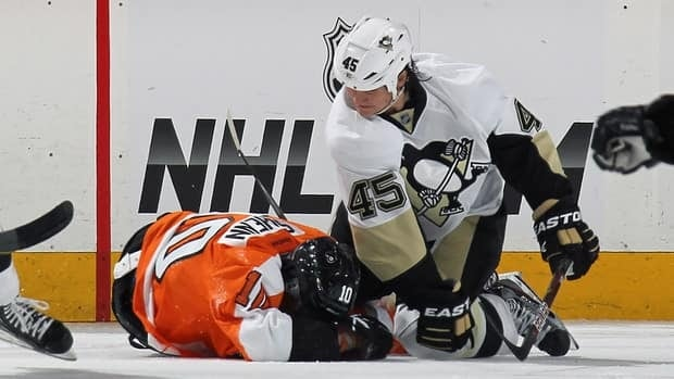 Arron Asham (45) of the Pittsburgh Penguins punches Brayden Schenn (10) of the Philadelphia Flyers in Game 3 in Philadelphia on Sunday. Asham was suspended for four games by the NHL on Tuesday.