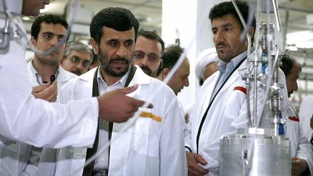 Iranian President Mahmoud Ahmadinejad, centre, visits the Natanz Uranium Enrichment Facility, south of the capital Tehran, Iran, in this 2008 photo. Iran has denied allegations it is building atomic weapons through its nuclear program.