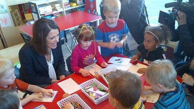 Wildrose Leader Danielle Smith joins children  colouring at a daycare in Sherwood Park, Alta.