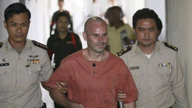 Thai prison guards escort Canadian Christopher Paul Neil, center, at criminal court in Bangkok, Thailand, in 2008.